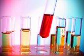 pic of tubes  - Test tube filled with red liquid on background of other tubes - JPG