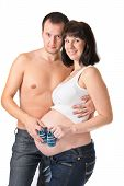 picture of youg  - Man and pregnant woman holding blue booties isolated on white - JPG