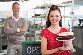 stock photo of cafe  - Cafe owners smiling at the camera at the cafe - JPG