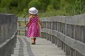 Little blond girl walking