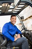 image of forklift driver  - Portrait of driver operating forklift machine in warehouse - JPG