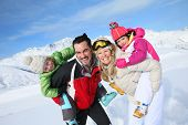 foto of family ski vacation  - Family having fun at the top of snowy mountain - JPG