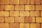 stock photo of wall-stone  - closeup of a orange stone wall or stone pavement background - JPG