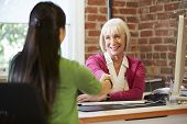 stock photo of interview  - Businesswoman Interviewing Female Job Applicant In Office - JPG