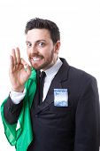 stock photo of sarcasm  - Businessman hiding Brazilian money and the flag of Brazil - JPG