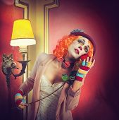 stock photo of clown rose  - Dramatic expression of a clown with rose - JPG