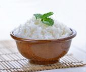 pic of ceramic bowl  - Cooked white rice garnished with mint in a ceramic bowl - JPG