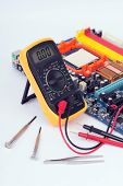 picture of  multimeter  - Digital multimeter and hand tools for the repair of electronics - JPG