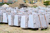 picture of slab  - Large slabs of granite secured by belts on pallets - JPG