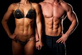 Fitness Couple Poses In Studio - Fit Man And Woman poster