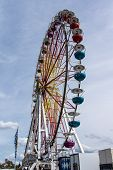 stock photo of ferris-wheel  - Ferris wheel on the fairground of the Spring Festival and the Octoberfest in Munich - JPG