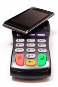 foto of terminator  - Payment terminal and mobile phone with NFC technology credit card reader payment terminal finance concept - JPG