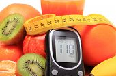 stock photo of immune  - Glucose meter fresh ripe natural fruits with tape measure and glass of juice on cutting board concept for diabetes healthy nutrition and strengthening immunity - JPG