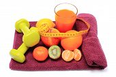 image of immune  - Fresh fruits with tape measure glass of juice and green dumbbells for fitness lying on purple towel concept for slimming healthy nutrition and strengthening immunity - JPG