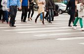 image of pedestrian crossing  - legs of pedestrians on a pedestrian crossing on summer day - JPG