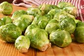 picture of brussels sprouts  - Fresh brussels sprouts on a rustic wooden table - JPG