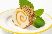 image of peppercorns  - slice of swiss roll with peppercorns on white plate - JPG