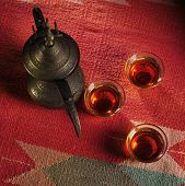 image of nomads  - Set of three arabic coffee cups and old coffee pot - JPG