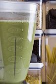 picture of blender  - Plastic container blender with green liquid mass - JPG