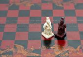 image of wise  - wise old men Chinese chess pieces on the chessboard - JPG