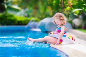 image of floating  - Kids in swimming pool - JPG