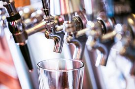 stock photo of draft  - Close up of beer lines for draft beer in restaurant - JPG