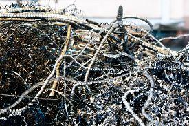 stock photo of scrap-iron  - large pile of waste metal scrap in the big steel tank - JPG