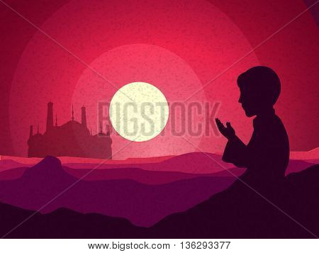 Religious Muslim Boy reading Namaz (Islamic Prayer) in front of a Mosque, Beautiful view of desert i