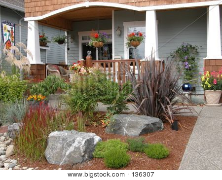 Or photo of the driveway and front yard of a craftsman style home