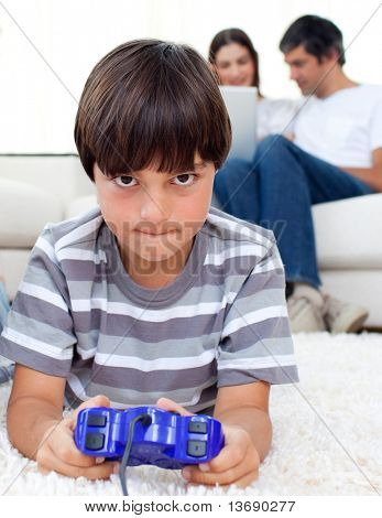 poster of Pensive boy playing video games lying on a floor