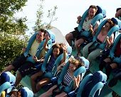 picture of amusement park rides  - family on vacation riding a rollercoaster together  - JPG