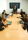 pic of business meetings  - businesspeople in a business meeting in an office smiling - JPG