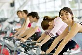 stock photo of gym workout  - People In A Class At The Gym - JPG
