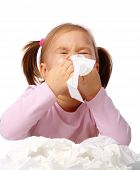 picture of cute little girl  - Little girl blows her nose isolated over white - JPG