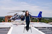 stock photo of medevac  - A beautiful woman using a set of medical crutches to help her walk - JPG