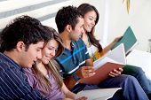stock photo of young adult  - Group of young people studying at home - JPG