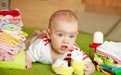 picture of babygro  - baby girl with heap of children - JPG