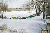 stock photo of flatboat  - Winter season at boating station in Ukraine - JPG