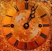 stock photo of pendulum clock  - beautiful gold clock face - JPG
