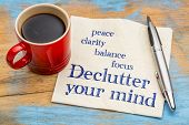 Declutter your mind for clarity, peace, focus and balance - handwriting on a napkin with a cup of es poster