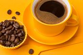 Yellow Cup With A Drink Of Coffee With Foam On A Yellow Background, Next Coffee Beans And A Yellow S poster
