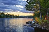 stock photo of breathtaking  - Dramatic sunset and pines at Lake of Two Rivers in Algonquin Park Ontario Canada - JPG