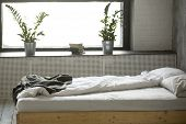Unmade Messy Double Bed For Two With Crumpled Bedding Sheet Linen Near Window In Modern Comfortable  poster
