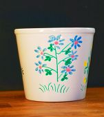 foto of loamy  - Flowerpot painted by hands. Markers an oven.