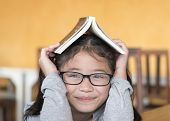 Educational Literacy, World Book Day Concept With Smart Asian School Student Girl Kid With Eyeglasse poster