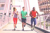 Multiethnic Runners On Urban Background - Group Of Multiracial Friends Jogging In City At Spring Tim poster