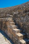 Closeup photo of steps of Roman amphitheatre in the ruins of Hierapolis, in Pamukkale, near modern t poster