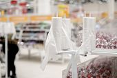 Rack Stand With Free Plastic Bags - Cellophane Package In The Supermarket Store. Environmental Pollu poster