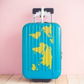 Suitcase With World Map And Airplane Model Toy Against Pastel Pink Wall Minimal Travel Vacation Crea poster