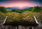 Sunset In A Mountain Valley On The Pages Of An Open Magical Book. Majestic Landscape. Nature And Edu poster